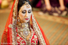 This Indian bride celebrates at her Sikh wedding.