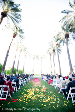This Indian Christian ceremony includes a beautiful petal-scattered aisle.