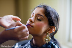 This Indian bride gets all dolled up with lovely makeup for her wedding.