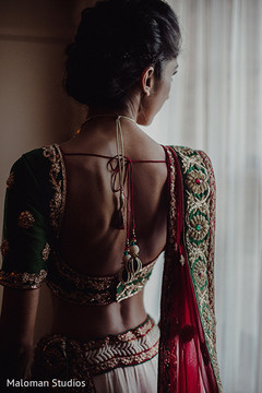 This Indian bride opts for a traditional lengha choli for her wedding day.