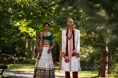 This Indian bride and groom pose for beautiful outdoor wedding portraits.