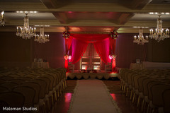 This Indian wedding ceremony includes a beautiful mandap.
