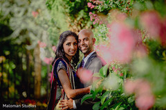 This Indian bride and groom pose for lovely reception portraits.