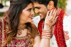 This Indian bride and groom pose for beautiful outdoor portraits.