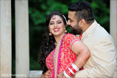 An Indian bride and groom pose for portraits before their reception!