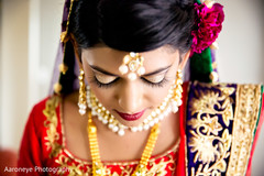 This Indian bride gets all dolled up for her wedding ceremony.