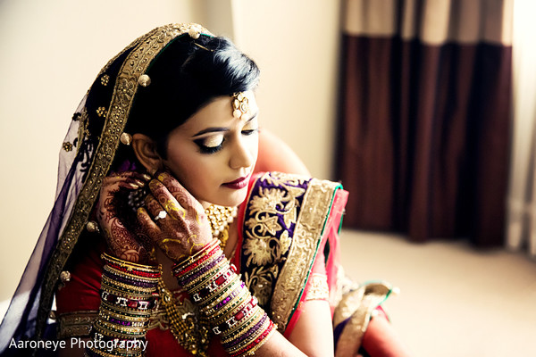 indian bride,indian bride getting ready,portraits of indian wedding,indian weddings,indian bride makeup,indian wedding makeup,indian bridal hair and makeup,indian wedding bangles,indian bridal bangles