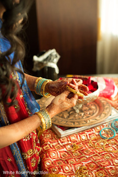 indian bride,indian bride getting ready,portraits of indian wedding,indian weddings,indian wedding bangles,indian bridal bangles