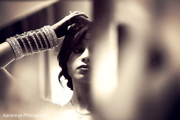 indian bride,bride getting ready,indian bride getting ready,images of indian bride,getting ready images,images of bride,bride,black and white photography,bridal jewelry,bridal bangles,bridal bracelets,Indian bridal bracelets,banga,churis