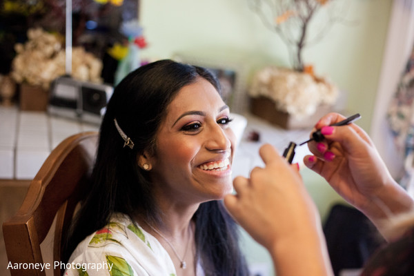 indian bride,indian bride getting ready,portraits of indian wedding,images of bride,indian bridal hair and makeup,indian wedding makeup,indian bridal hair accessories