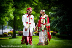 An Indian bride and groom pose for portraits at their wedding!