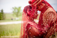 An Indian bride and groom pose for some precious portraits after their wedding!