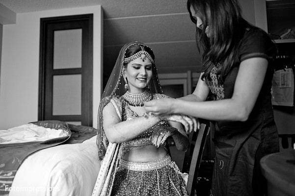 indian bride,bride getting ready,indian bride getting ready,images of indian bride,getting ready images,images of bride,bride,black and white photography,black and white photo,black and white