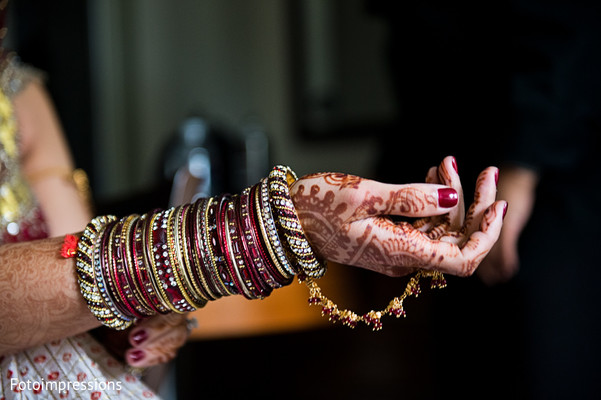 indian bride,indian bride getting ready,portraits of indian wedding,indian weddings,indian bridal jewelry,indian wedding jewelry,bridal indian jewelry,indian wedding jewelry sets,indian bridal bracelets,indian wedding bangles