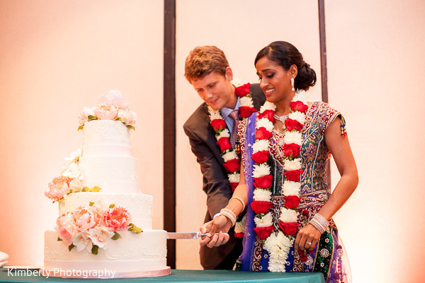 Cake cutting in Tampa, FL Indian Fusion Wedding by Kimberly Photography
