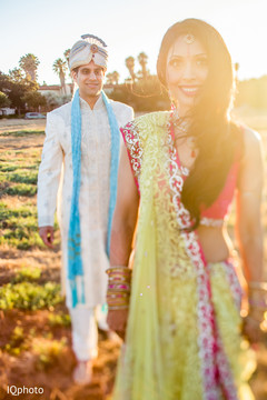 An Indian bride and groom bring a splash of color to their pre-wedding celebrations!