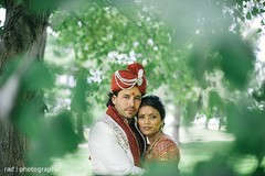 The couple take portraits before wedding.