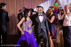 An Indian bride and groom celebrate their union at their wedding reception.