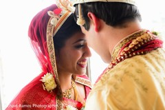 An Indian bride and her groom pose for pics after their wedding ceremony!