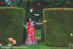 An Indian bride and groom pose of wedding portraits!