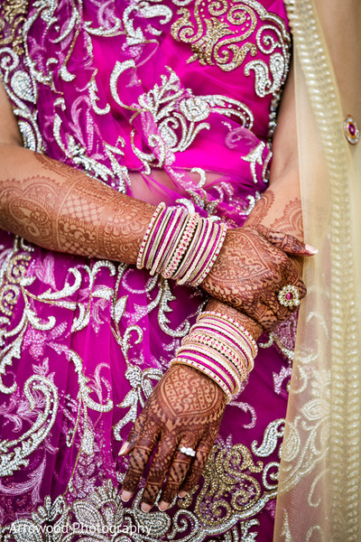 indian bride getting ready,indian wedding bangles,indian wedding mehndi