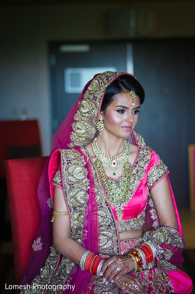 indian bride makeup,indian wedding makeup,indian bridal hair and makeup,portraits of indian wedding,indian bride,indian bridal fashions,indian bride photography,indian wedding photo,indian weddings,gold indian wedding jewelry,indian bridal jewelry