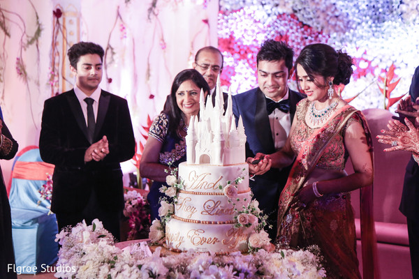 Cake Cutting in Mumbai Indian Wedding by Flgroe Studios