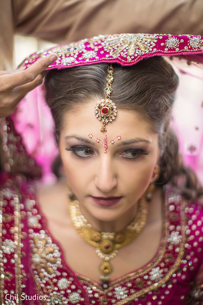 indian bride getting ready,indian bridal hair and makeup,tikka,tikkah
