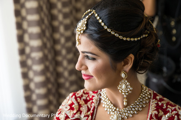 indian bride getting ready,earrings,indian bridal hair accessories