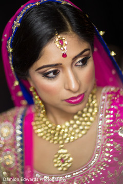 indian bride getting ready,indian wedding makeup,indian weddings