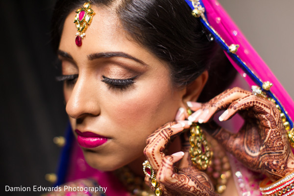 indian bride getting ready,indian wedding makeup,indian wedding mehndi