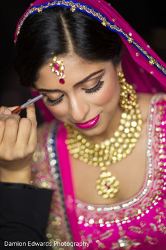 indian bride getting ready,indian wedding makeup