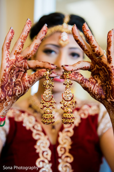 indian bride getting ready,indian weddings,indian wedding mehndi