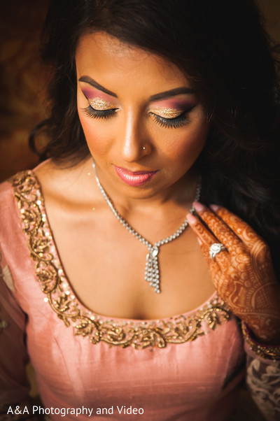 indian bride getting ready,indian bridal hair and makeup,indian wedding makeup,indian wedding necklace,silver jewelry,indian wedding mehndi
