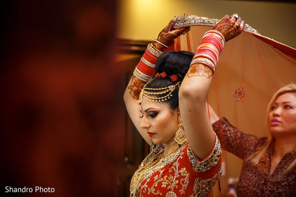 indian bride getting ready,indian bridal hair and makeup,indian wedding makeup,indian bridal hair accessories