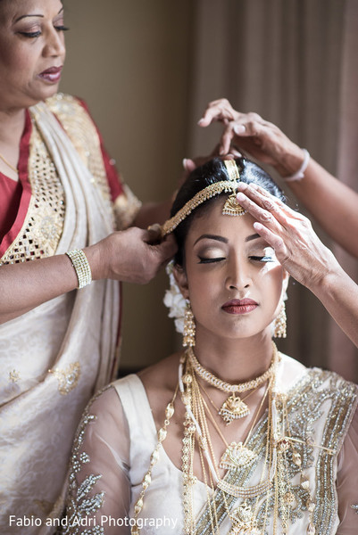 indian bride getting ready,indian bridal hair and makeup,gold indian wedding jewelry,indian weddings