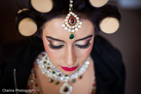 indian bride getting ready,indian wedding makeup,tikka
