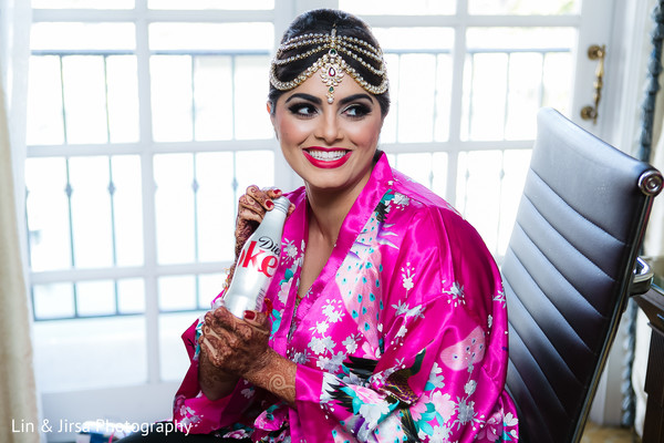 indian bride getting ready,indian bridal hair and makeup,indian wedding makeup,tikka