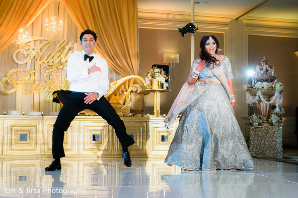 indian fusion wedding reception,indian sari,tuxedo,indian bridal hair and makeup,sweetheart stage,indian bride and groom first dance