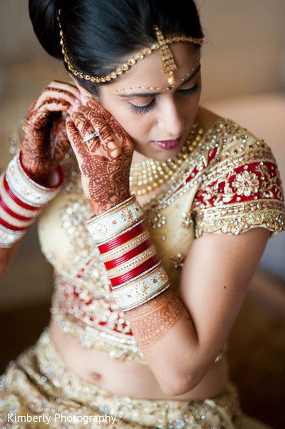 indian bride getting ready,indian bridal hair and makeup,indian weddings,indian wedding bangles,indian wedding mehndi