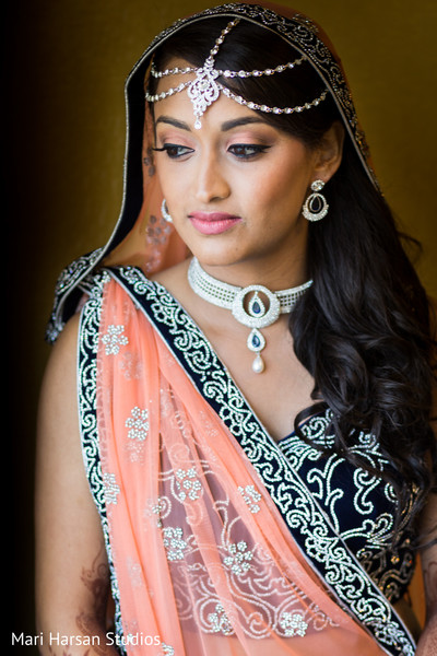indian bride getting ready,indian bridal hair and makeup,indian weddings,indian wedding necklace