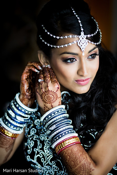 indian bride getting ready,indian bridal hair and makeup,indian wedding bangles