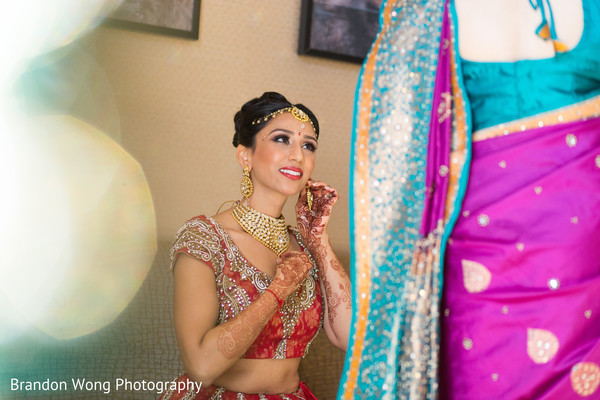 getting ready,hair and makeup,gold bridal set,necklace,tikka,earrings,mehndi