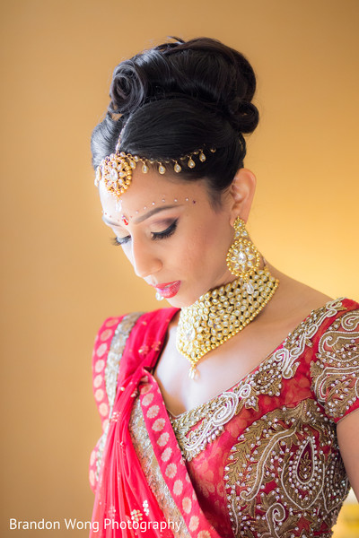 getting ready,hair and makeup,hair,makeup,gold bridal set,necklace,tikka,earrings