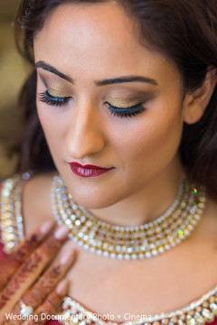 indian bride getting ready,indian bridal hair and makeup,indian wedding makeup,indian wedding necklace
