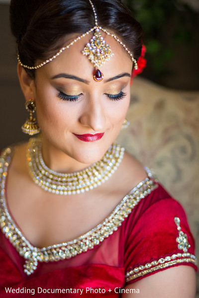 getting ready,hair and makeup,makeup,tikka,necklace,earrings,gold bridal set