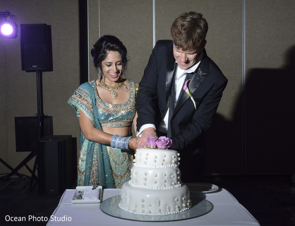 reception fashion,reception lengha,suit,cake cutting,cake