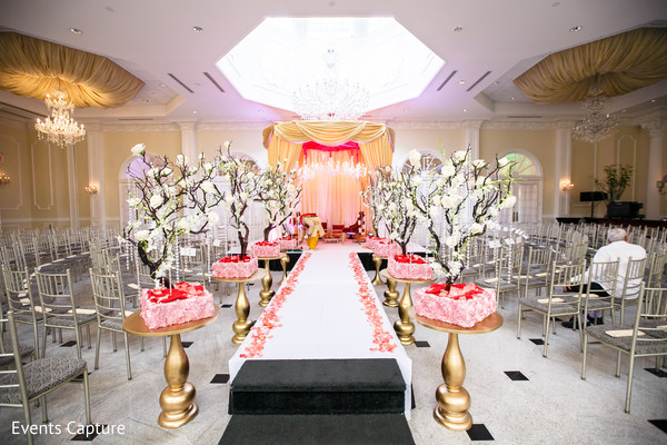 ceremony,indian wedding,indian ceremony,indian wedding ceremony,mandap,aisle decor,floral arrangements,ceremony mandap,indoor mandap