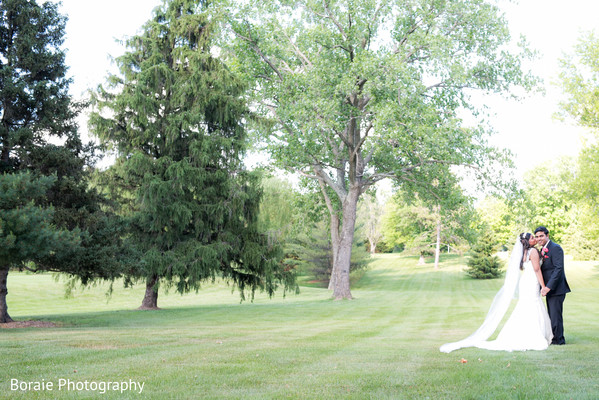 first look,first look portraits,white wedding dress,suit,outdoor portraits