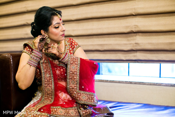 getting ready,hair and makeup,bridal jewelry,gold bridal set,earrings,bangles,churis